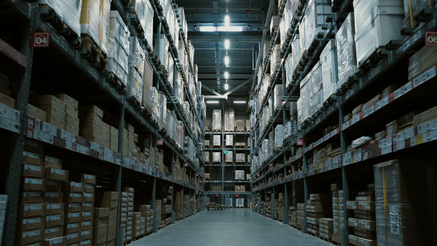 Steadycam shot of big warehouse with many goods for building or repair. Shopping mall or stock with stuff for decoration