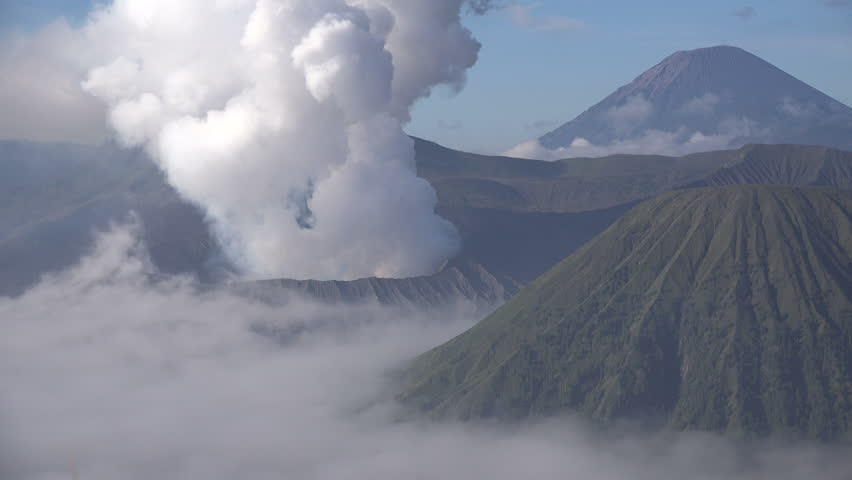 Time lapse of famous Mount Bromo volcano billowing smoke on East Java island in Indonesia | Shutterstock HD Video #29473924