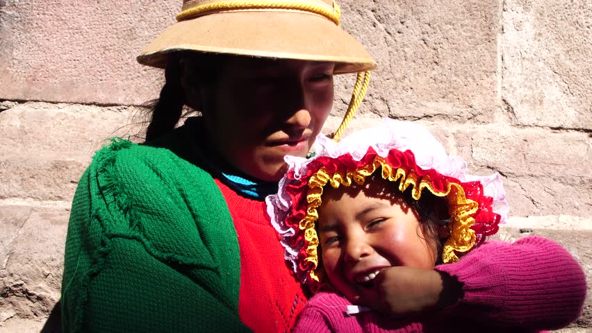 Andean indigenous woman and daughter in traditional inca customs in Cusco, Peru | Shutterstock HD Video #29482084