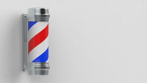 a rotating barber shop pole motion on white cement wall background footage.