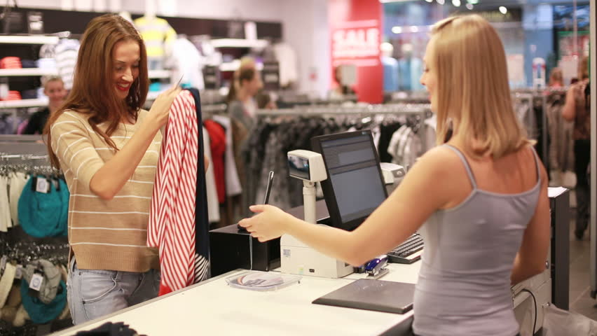 Lovely girl paying for her garments by credit card