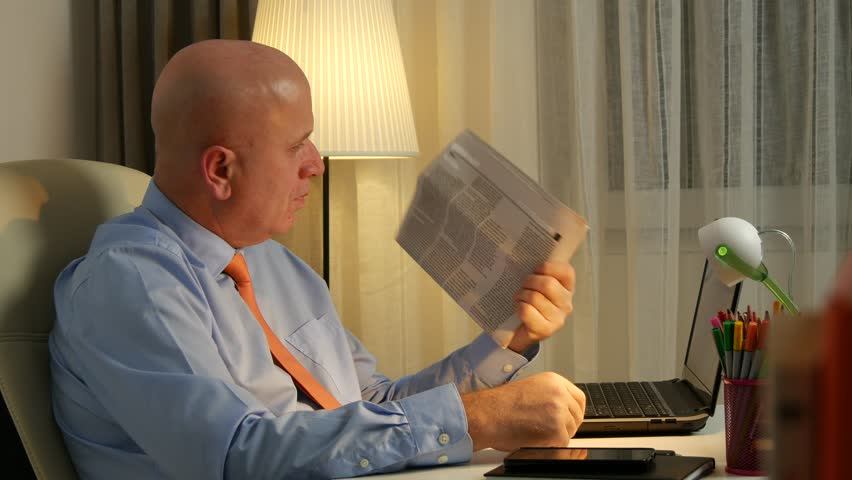 Businessman In Office Room Reading A Newspaper In A Working Break (Ultra  High Definition,