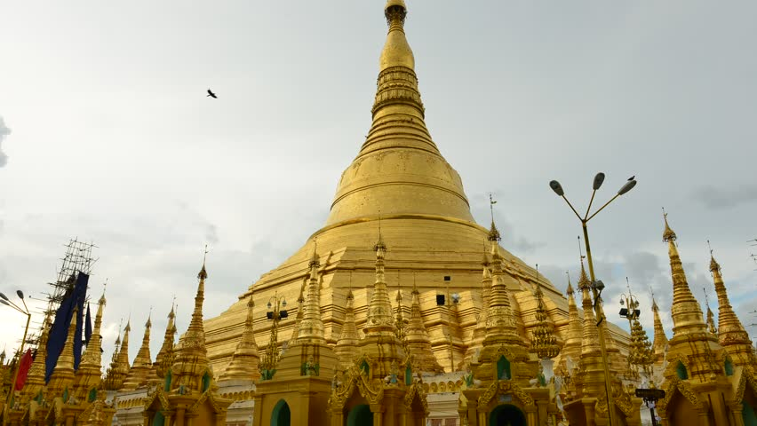 YANGON, MYANMAR - OCTOBER 24: Time lapse of tourists walking around the Shwedagon Pagoda Yangon on October 24, 2012 in Yangon, Myanmar