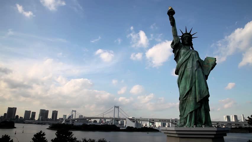 TOKYO, JAPAN – NOVEMBER 10: Statue of Liberty replica at Odaiba, overlooking the Rainbow Bridge in Tokyo Bay November 10, 2011 | Shutterstock HD Video #2950024