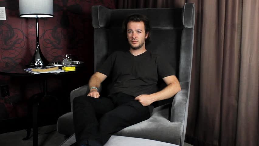 Depressed man sits alone | Shutterstock HD Video #2960584
