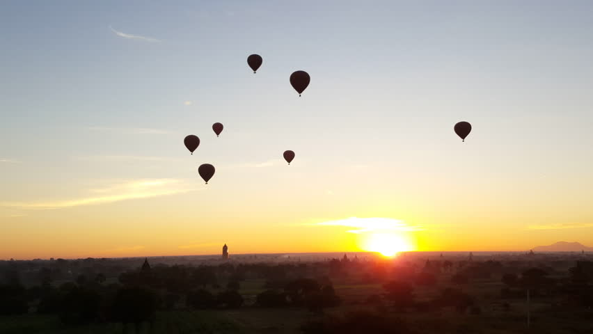 Bagan landscape at dawn, hot air balloons silhouette, sunrise, horizon, Myanmar #29678404
