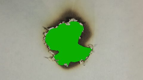 Burning paper. Green screen.