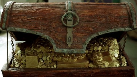 A wooden chest with gold coins.