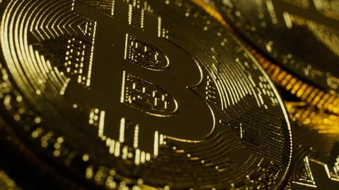 Crypto currency Gold Bitcoins - BTC - Bit Coin. Macro shots crypto currency Bitcoin coins rotating. Seamless looping.