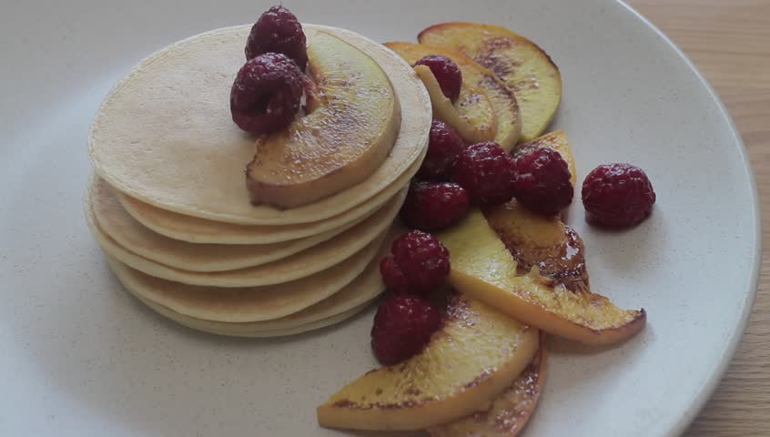 Delicious chocolate pancakes with berries how to make it stock pancakes hd stock footage clip ccuart Choice Image
