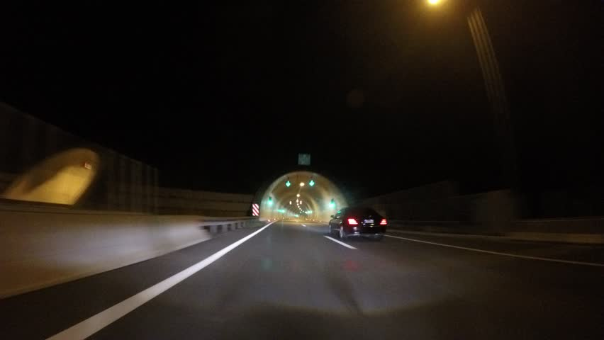 Driving car with adaptive headlights through a tunnel