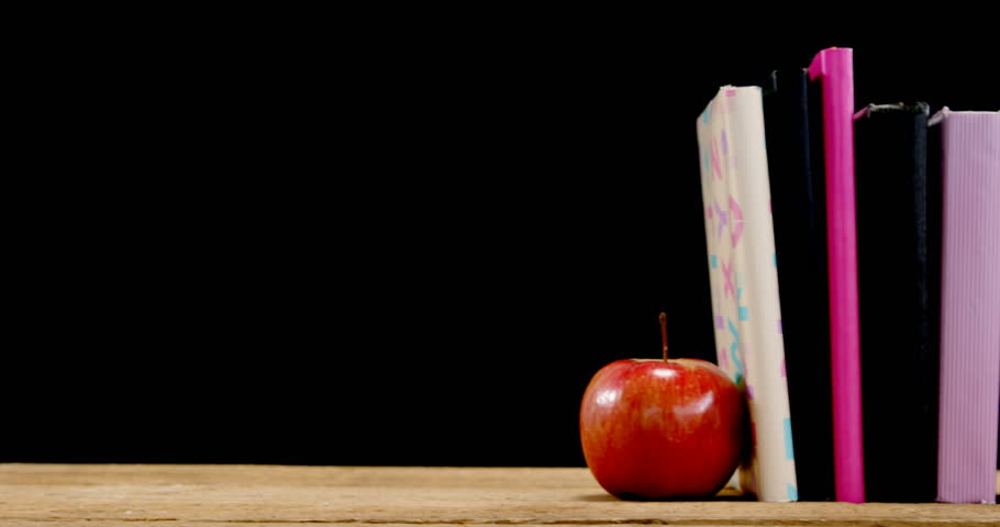 Apple And Book On Table Against Black Background Stock Footage Video 29758774