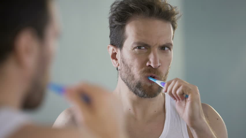 Middle-aged bachelor brushing his teeth, morning routine, taking care of health #29810794