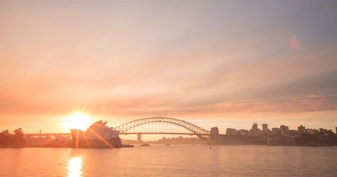 SYDNEY - AUSTRALIA - AUGUST 14: (Timelapse) A beautiful sunset over Sydney Harbour as smoke from nearby back burning creates stunning colours in the sky as day turns to night on AUGUST 14, 2017.