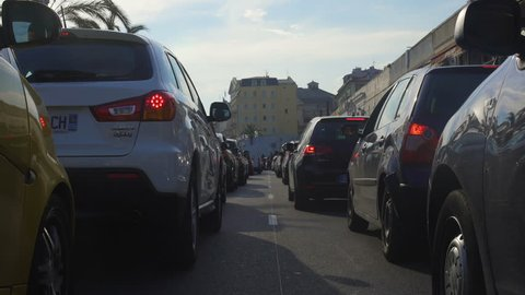 NICE, FRANCE - CIRCA JUNE 2016: Sightseeing in the city. Traffic jam, large number of cars slowly moving on Promenade des Anglais, Nice