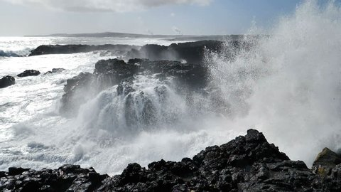Powerful waves crashing on rocky coast slow motion Brimketill Reykjanes Iceland