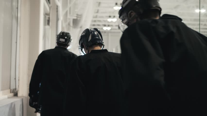 Ice hockey players, team friends go to bench to start game, cold arena, power athlete hockey player go to arena from dressing room | Shutterstock HD Video #29847484