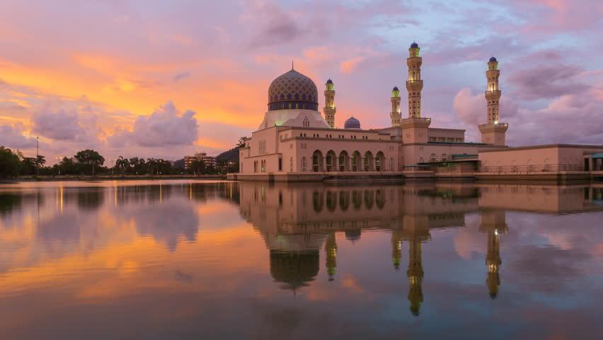 Time lapse of sunset and scattered clouds at the Likas Mosque or Masjid Bandaraya Likas in Likas, Kota Kinabalu, Sabah, Malaysia. 4K resolution, 3840 x 2160.