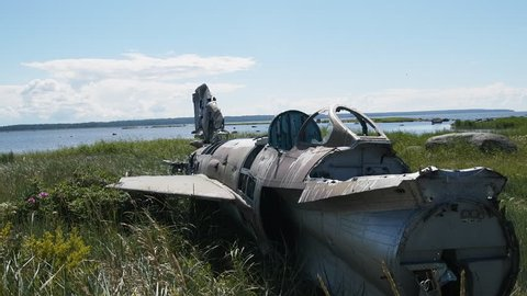 Unique video. war plane crashed on shore of sea several years ago and lies on grassy dunes