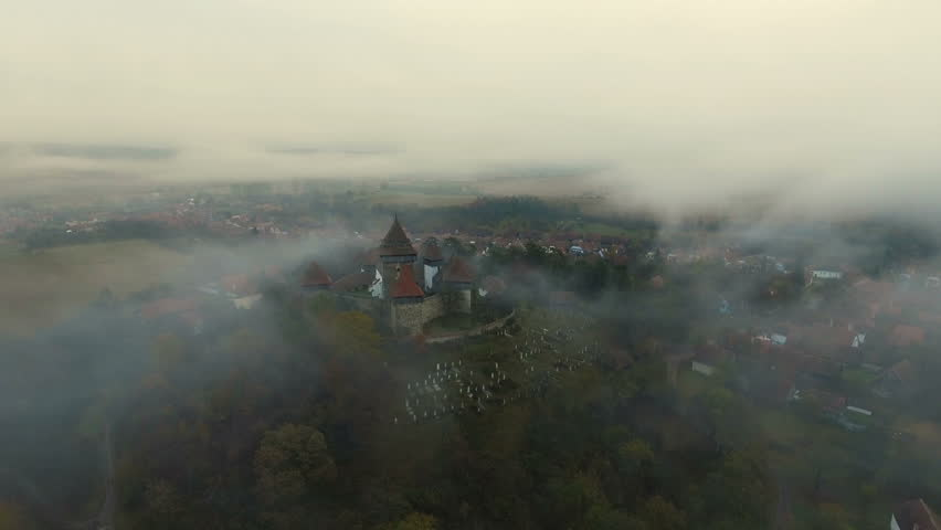 4k aerial drone slow shot over saxon village Viscri. Countryside view with Viscri fortified church in the middle surrounded by saxon houses. Transylvania, Romania. 4k footage.