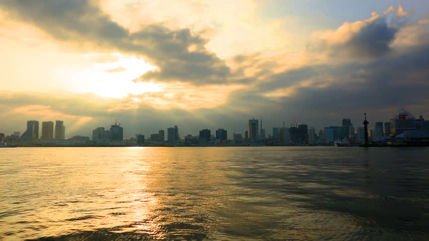 Cloudy sky over skyscrapers at sunset, Odaiba, Tokyo, Japan.  | Shutterstock HD Video #29906974