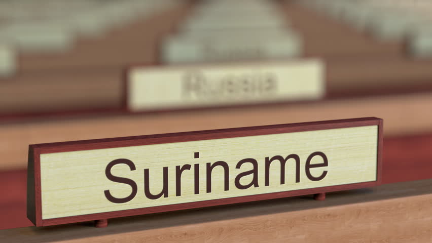 Suriname name sign among different countries plaques at international organization. 3D rendering