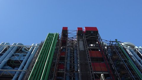The pipework for the internal services on the Rue du Renard side of the Centre Georges Pompidou (1977) , Paris, France street tilt down.