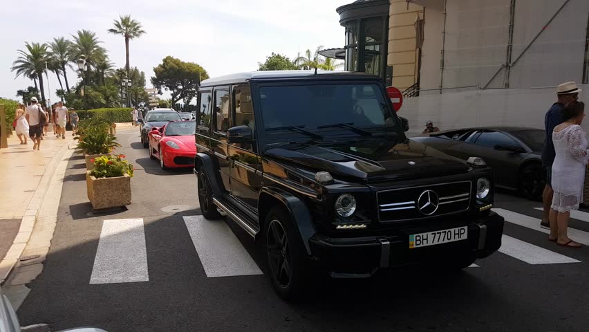 Monte-Carlo, Monaco - August 17, 2017:  Man Driving A Luxurious SUV Mercedes-Benz Class G In Front Of Monte-Carlo Casino In Monaco, French Riviera - 4K Video