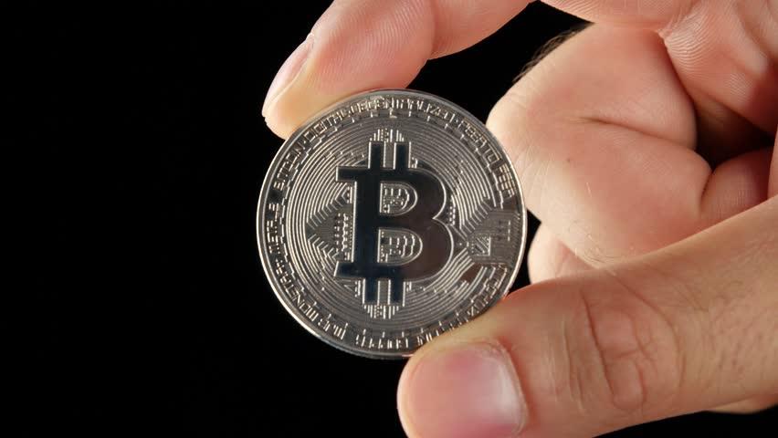 Hand Holding Silver Bitcoin Virtual Money