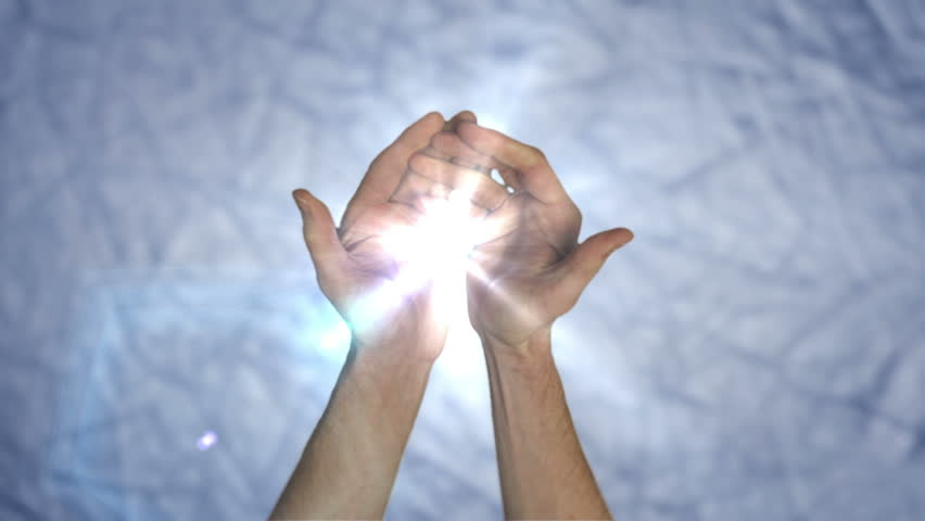 HD: Hands giving light of creation Full HD clip with hands showing the gift of light, which could symbolize creation, life, soul and love. Combination of HD film and added effects.