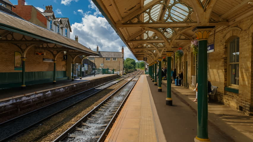 KNARESBOROUGH, August 2017 - A POV gimbal shot along a traditional Victorian English train station in the village of Knaresborough, Yorkshire, England, UK