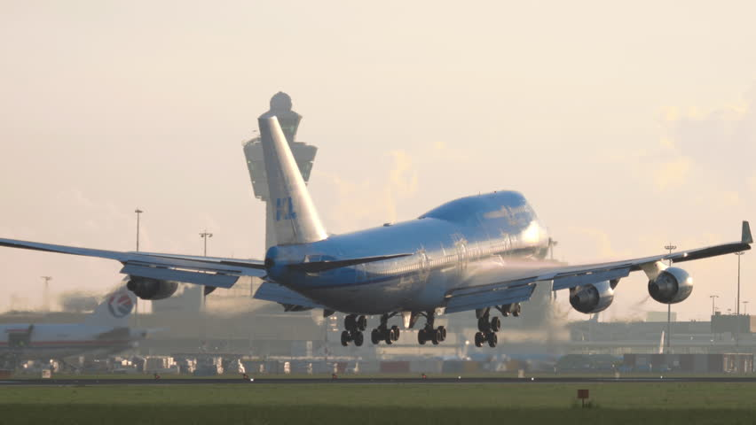AMSTERDAM, THE NETHERLANDS - JULY 25, 2017: KLM Boeing 747 PH-BFR approaching and landing at runway 06 Kaagbaan at sunrise. Shiphol Airport, Amsterdam, Holland   Shutterstock HD Video #29975314