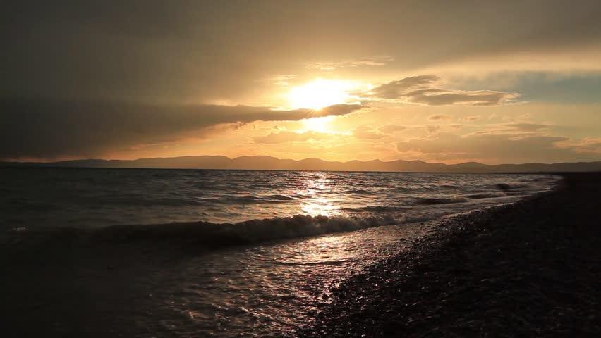 Stormy sunset over a mountain lake. Kyrgyzstan, Son-Kul lake   Shutterstock HD Video #29987884