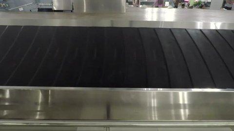 Video footage of empty baggage conveyor belt in the airport