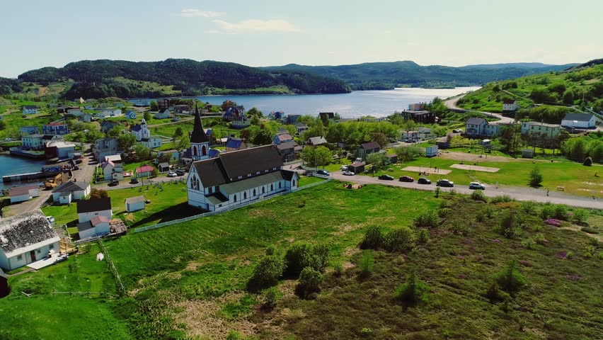 A beautiful aerial shot of a large church and historic town in Trinity Newfoundland Nova Scotia