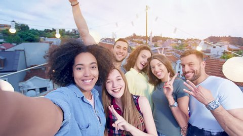 Young Teens At Celebration Rooftop Party Taking A Pickture Using A Selfie Stick Looking Excited Excited Youth Party People Birthday Celebration During Beautiful Urban Sunset Shot on Red Epic W 8K Slow