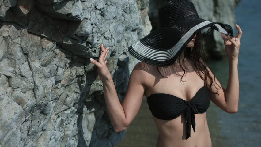 Portrait of the cute girl in the beach hat and the black bikini | Shutterstock HD Video #30020479