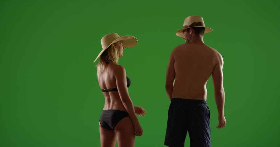 Two millennials having a romantic getaway on green screen. On green screen to be keyed or composited.