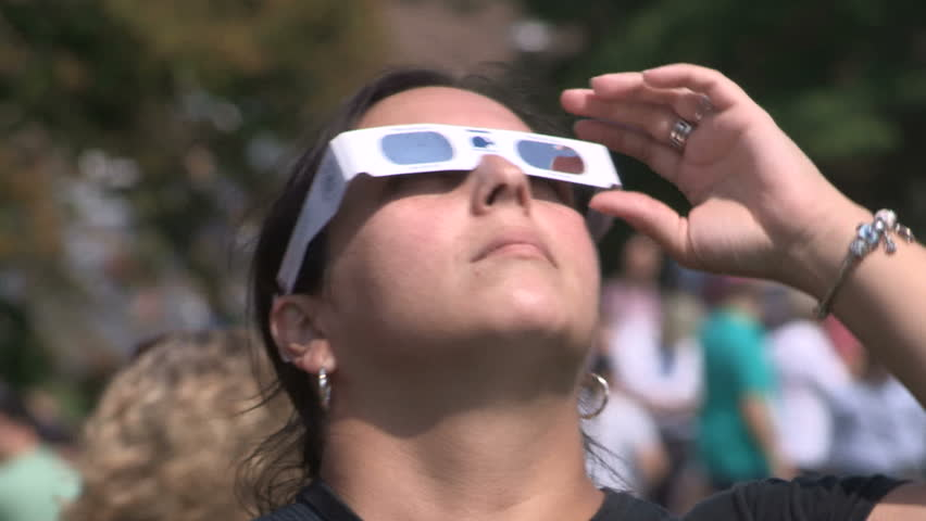 Waterloo, Ontario, Canada August 21 2017 Solar eclipse on college campus and students with telescopes and glasses
