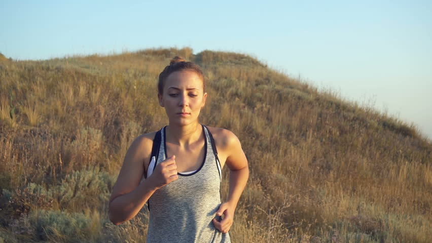 Beautiful girl doing morning jogging at sunrise in the field. outdoors fitness | Shutterstock HD Video #30085654