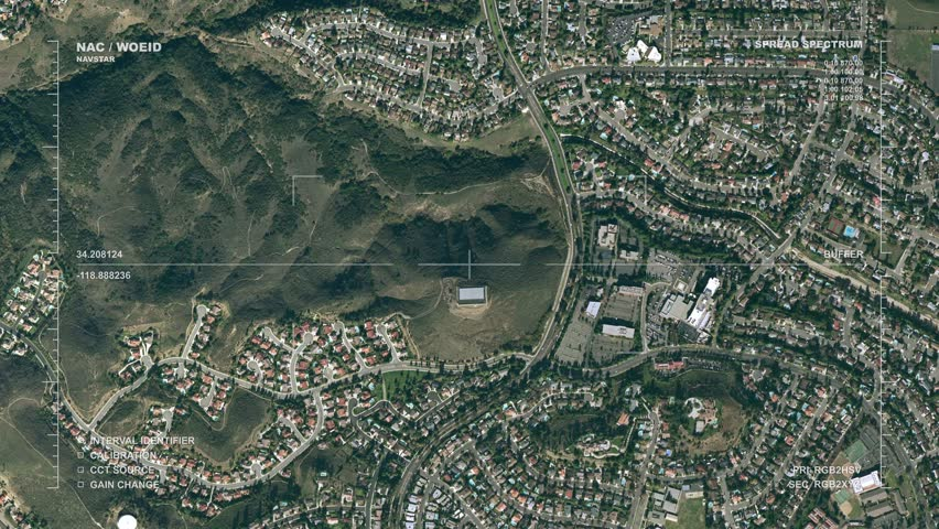 Sequence of aerial surveillance displays: small city center, office park, residential area. Reversible, seamless loop. Real-life geoimaging readout lexicon and labels.