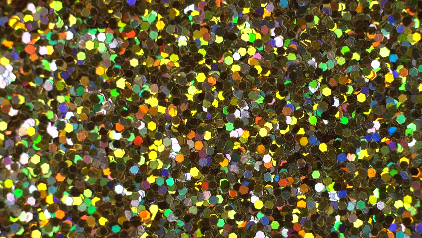 Abstract multicolor sequins glitter spin, glowing paillette close-up.