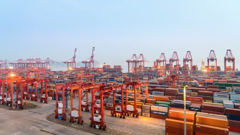 SHANGHAI, CHINA - Aug 21, 2017: Time lapse of Shipping Container Terminal in Nightfall, Busy modern harbor in Yangshan deep water port. August 21, 2017 in Shanghai ,China.