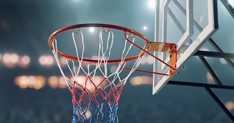 Close up of a Basketball hoop with a ball.