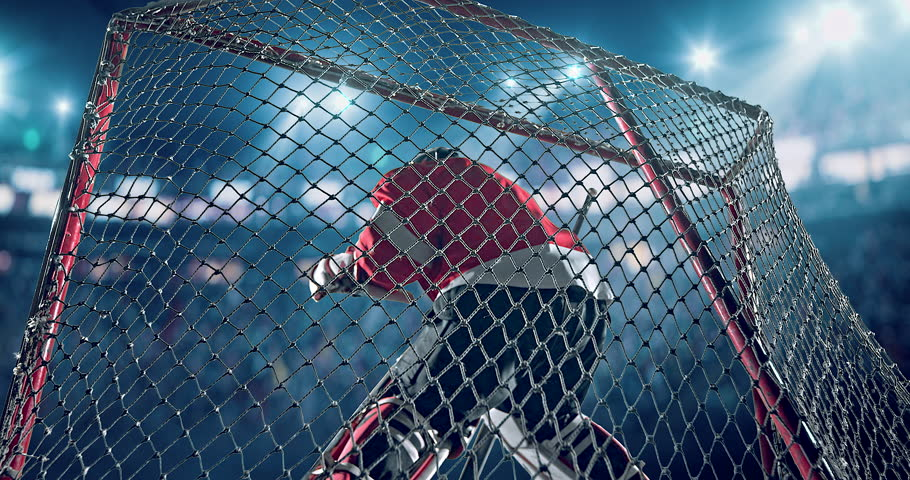 Ice Hockey goalie fails a goal on a hockey arena with intensional lens flares. He is wearing unbranded sports clothes.