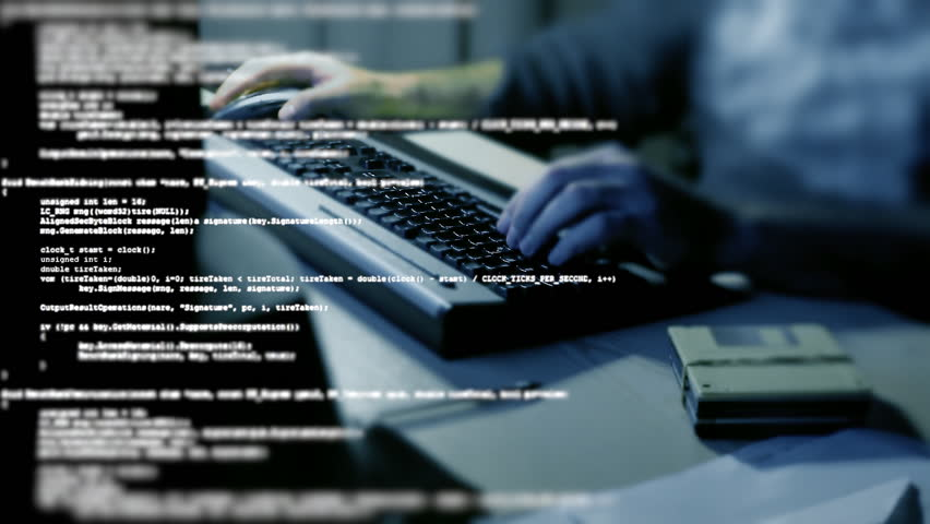 A flow of source code text program instructions in tilt-shift, overlayed on the hands of a man typing on a computer pc keyboard.  | Shutterstock HD Video #30132481
