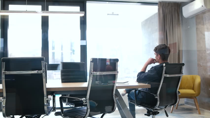 Businessman relaxing in meeting room after compleated work | Shutterstock HD Video #30137344
