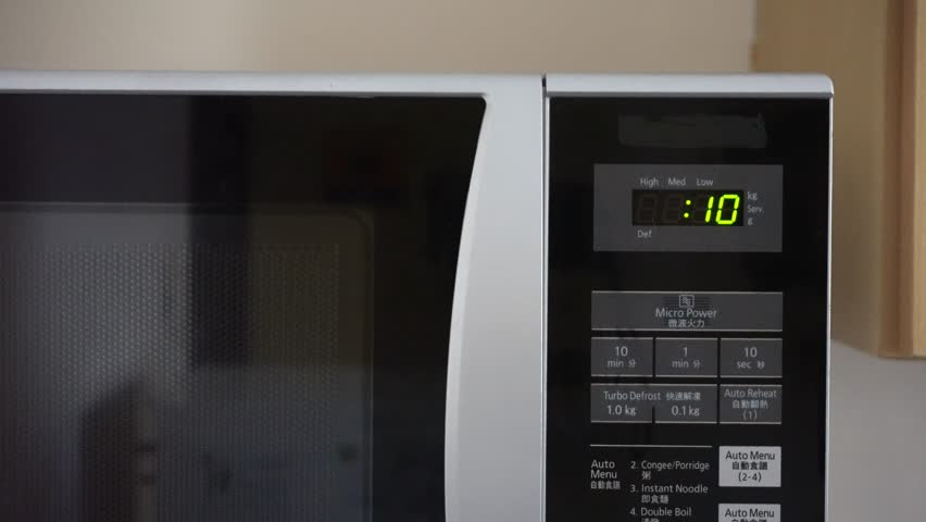 Digital microwave timer counting down from ten