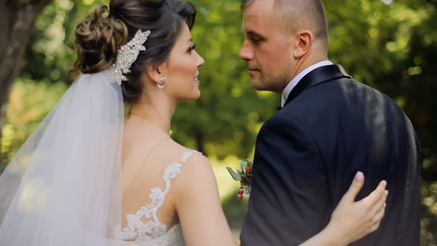 Young Beautiful Bride And Groom Walk Talk In The Garden Wedding Bouquet Feel