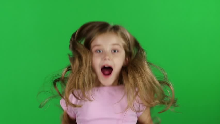 Baby jumps, emotions of happiness and fun. Green screen. Slow motion